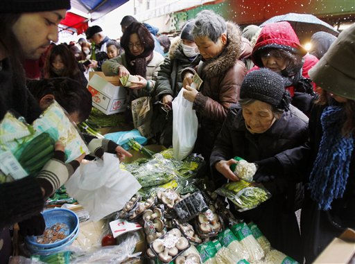 Local residents crowd a morning market with fresh vegetable that just arrived for sale at Sendai, northeastern Japan, on Thursday, March 17, 2011 following last week&#39;s massive earthquake and resulting tsunami. &#40;AP Photo&#47;Kyodo News&#41;  <span class=meta>(Photo&#47;Anonymous)</span>