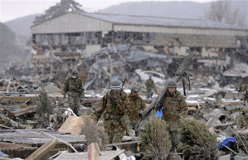 Japan Ground Self-Defense Force members search though the rubble in the snow in Ishinomaki, Miyagi Prefecture, northern Japan, Thursday, March 17, 2011. &#40;AP Photo&#47;Kyodo News&#41;  JAPAN OUT, MANDATORY CREDIT, NO LICENSING IN CHINA, HONG KONG, JAPAN, SOUTH KOREA AND FRANCE <span class=meta>(AP Photo&#47; Anonymous)</span>