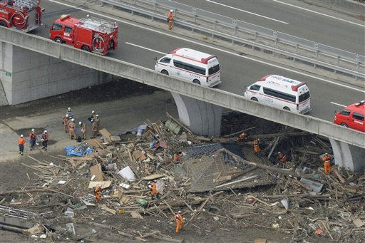 Rescuers continue a search operation in Sendai, northern Japan Thursday, March 17, 2011 following Friday&#39;s massive earthquake and tsunami. &#40;AP Photo&#47;Kyodo News&#41; JAPAN OUT, MANDATORY CREDIT, NO LICENSING IN CHINA, HONG KONG, JAPAN, SOUTH KOREA AND FRANCE <span class=meta>(AP Photo&#47; Anonymous)</span>