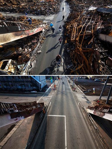 In this combination photo, Japanese residents of Kesennuma, northeastern Japan, pass through a road that was cleared by bulldozer through the ruins of the city on March 17, 2011, six days after the tsunami, top, and people cross the same street on Thursday, Feb. 23, 2012. One year after a powerful tsunami battered Japan and killed around 19,000 people, the streets have been cleared and the wreckage removed from town centers. But the process of destroying all that debris has been slow, with much of it still sitting in huge mountains in temporary holding areas. &#40;AP Photo&#47;David Guttenfelder&#41; <span class=meta>(AP Photo&#47; David Guttenfelder)</span>