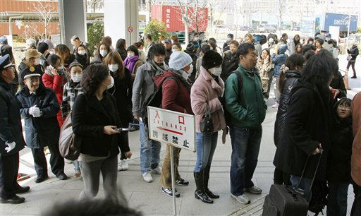 Foreigners form a long line at Tokyo Immigration Bureau in Tokyo Thursday, March 17, 2011 to get re-entry permits to Japan as international worries grew about health risks from Japan&#39;s leaking nuclear plants. &#40;AP Photo&#47;Kyodo News&#41; <span class=meta>(Photo&#47;Anonymous)</span>
