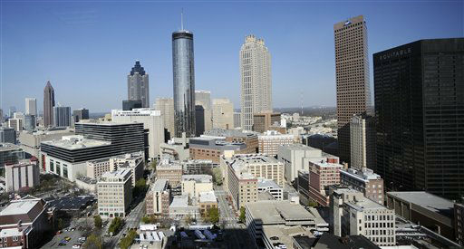 The Atlanta skyline is shown Thursday, March 17, 2011. According to census data released Thursday Atlanta&#39;s population slowed over the last 10 years with the city adding only 1 percent as people fled to the suburbs seeking better schools, cheaper homes and safer neighborhoods. &#40;AP Photo&#47;Mike Stewart&#41; <span class=meta>(AP Photo&#47; Mike Stewart)</span>