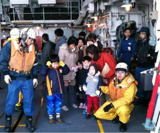 "<div class=""meta ""><span class=""caption-text "">In this image released by the Japan Defense Ministry, earthquake victims wait to be airlifted from the destroyer DD Takanami class to a safer place, in waters off the devastated port town of Ishinomaki, northeastern Japan, on Monday, March 14, 2011. (AP Photo/Japan Self-Defense Force) (Photo/Anonymous)</span></div>"