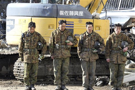 Japanese soldiers observe a moment of silence to the wail of siren at the devastated city of Miyako, northeastern Japan, on Friday, March 18, 2011, just one week after a massive earthquake and resulting tsunami. &#40;AP Photo&#47;Yomiuri Shimbun, Naoya Masuda&#41; <span class=meta>(Photo&#47;Naoya Masuda)</span>