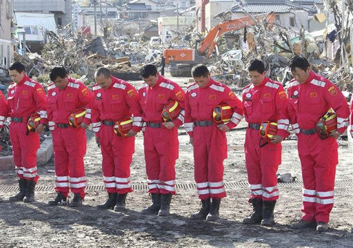A Chinese search and rescue team observes a moment of silence at the devastated city of Ofunato, northeastern Japan, on Friday, March 18, 2011, just one week after a massive earthquake and resulting tsunami. &#40;AP Photo&#47;Yomiuri Shimbun, Masamichi Genko&#41; <span class=meta>(Photo&#47;Masamichi Genko)</span>