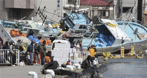 "<div class=""meta ""><span class=""caption-text "">Local residents wait for a ship to travel to a nearby island from the devastated city of Kesennuma, northeastern Japan, on Friday, March 18, 2011, just one week after a massive earthquake and resulting tsunami. (AP Photo/Yomiuri Shimbun, Kaname Muto) JAPAN OUT, MANDATORY CREDIT (AP Photo/ Kaname Muto)</span></div>"