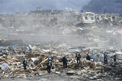 Police officers work on recovery operations in Otsuchi, northern Japan, Saturday, March 19, 2011, after an earthquake and its subsequent tsunami. &#40;AP Photo&#47;The Yomiuri Shimbun, Yoichi Hayashia&#41; JAPAN OUT, MANDATORY CREDIT <span class=meta>(AP Photo&#47; Yoichi Hayashi)</span>