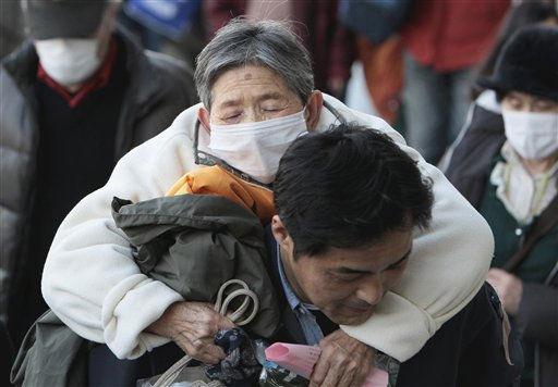 ADDS COUNTRY - A volunteer carries a woman fled from Futaba, about five kilometers &#40;three miles&#41; from Fukushima Dai-ichi nuclear power plant, into an evacuation center in Saitama, Japan, Saturday, March 19, 2011, after last week&#39;s earthquake and tsunami. &#40;AP Photo&#47;The Yomiuri Shimbun, Atsushi Taketazu&#41; JAPAN OUT, MANDATORY CREDIT <span class=meta>(AP Photo&#47; Atsushi Taketazu)</span>