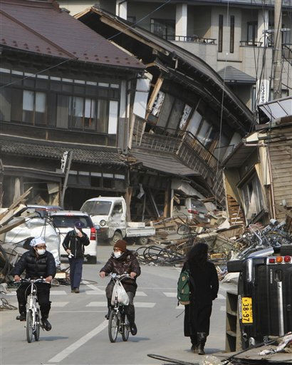 "<div class=""meta ""><span class=""caption-text "">ADDS COUNTRY - Evacuees travel through a devastated area in Kesennuma, northern Japan, Saturday, March 19, 2011, eight days after last week's earthquake and tsunami. (AP Photo/The Yomiuri Shimbun, Kaname Muto) JAPAN OUT, MANDATORY CREDIT (AP Photo/ Kaname Muto)</span></div>"