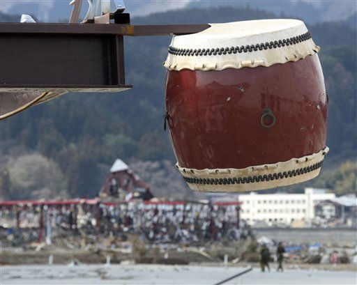 "<div class=""meta ""><span class=""caption-text "">A Japanese drum gets stuck on an iron bar in the devastated town of Rikuzentakata, Iwate prefecture, northeastern Japan, Saturday, March 19, 2011, following the last week's earthquake and tsunami. (AP Photo/Koji Sasahara) (AP Photo/ Koji Sasahara)</span></div>"