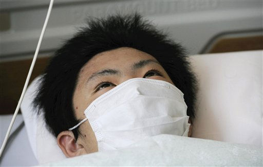 "<div class=""meta ""><span class=""caption-text "">Jin Abe, 16, lies on a bed at Red Hospital in Ishinomaki, Miyagi Prefecture, Japan, Monday, March 21, 2011, a day after being rescued. He and his grandmother Sumi, 80, were rescued when Jin was able to pull himself out of their flattened two-story home Sunday, nine days after the devastating earthquake and tsunami. (AP Photo/The Yomiuri Shimbun (Photo/Anonymous)</span></div>"