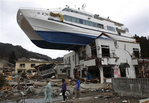 "<div class=""meta ""><span class=""caption-text "">A boat sits atop a building in Otsuchi, Iwate Prefecture, Japan, Tuesday, March 22, 2011, following the March 11 earthquake and tsunami which devastated a vast area of northeastern Pacific coast of Japan. (AP Photo/Yomiuri Shimbun) JAPAN OUT, MANDATORY CREDIT (AP Photo/ Hiroto Nomoto)</span></div>"