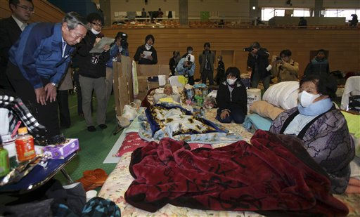 Norio Tsuzumi, vice president of Tokyo Electric Power Co. &#40;Tepco&#41;, left, apologizes evacuees at an evacuation center in Tamura of Fukushima Prefecture, Japan, Tuesday, March 22, 2011, following the March 11 earthquake and tsunami. Public sentiment is such that Fukushima&#39;s governor Yuhei Sato rejected a meeting offered by the president of Tepco, the utility that runs the Fukushima nuclear plant. &#34;Considering the anxiety, anger and exasperation being felt by people in Fukushima, there is just no way for me to accept their apology,&#34; said Gov. Sato on national broadcaster NHK.  <span class=meta>(AP Photo&#47; Koichi Nakamura)</span>