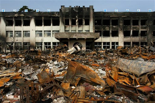 "<div class=""meta ""><span class=""caption-text "">In this Sunday, March 20, 2011 photo, a burned elementary school sits in the March 11 earthquake and tsunami-destroyed city of  Ishinomaki, northern Japan.(AP Photo/Mainichi Shimbun, Takashi Morita) JAPAN OUT, NO SALES, MANDATORY CREDIT (AP Photo/ Takashi Morita)</span></div>"