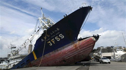 A ship is left washed ashore following the March 23, 2011 earthquake and tsunami in a pier at Onahama port in Iwaki, Fukushima Prefecture, northeastern Japan, Wednesday, March 23, 2011.    <span class=meta>(AP Photo&#47; Satoshi Oga)</span>