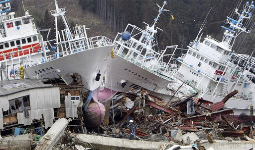 Big fishing boats are left washed ashore after the March 11 earthquake and tsunami in Kesennuma, Miyagi Prefecture, northeastern Japan, Wednesday, March 23, 2011.   <span class=meta>(AP Photo&#47; Kaname Muto)</span>