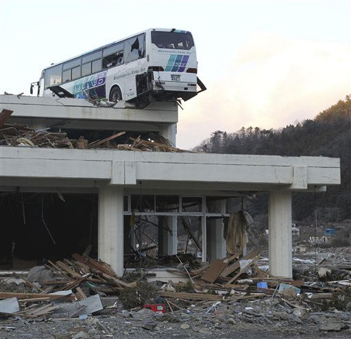 A bus sits atop a building following the March 11 earthquake and tsunami in Ishinomaki, Miyagi Prefecture, northeastern Japan, Wednesday, March 23, 2011.   <span class=meta>(AP Photo&#47; Yasufumi Nagao)</span>