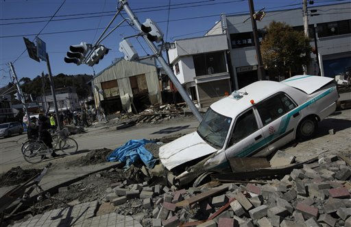 "<div class=""meta image-caption""><div class=""origin-logo origin-image ""><span></span></div><span class=""caption-text"">Survivors push bicycles along streets in the devastated city of Ishinomaki, Iwate prefecture, northeastern Japan, Thursday, March 24 2011, after an powerful earthquake and resulting tsunami devastated the area about two weeks ago.(AP Photo/Vincent Yu) (AP Photo/ Vincent Yu)</span></div>"