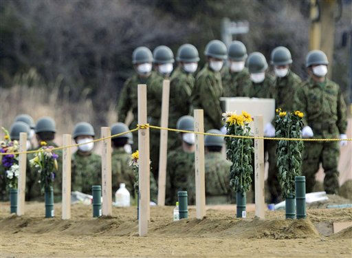 Japan&#39;s Self-Defense Force&#39;s members carry a victim&#39;s coffin at a burial site  in the March 11 earthquake and tsunami-destroyed city of Higashimatsushima, northern Japan Friday, March 25, 2011. &#40;AP Photo&#47;Yomiuri Shimbun, Miho Ikeya&#41; JAPAN OUT, MANDATORY CREDIT <span class=meta>(AP Photo&#47; Anonymous)</span>