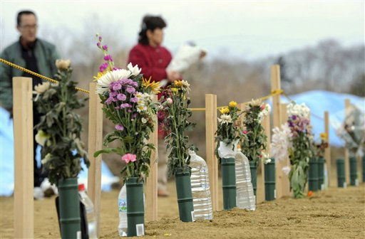 Flowers are offered at a burial site  in the March 11 earthquake and tsunami-destroyed city of Higashimatsushima, northern Japan Friday, March 25, 2011. &#40;AP Photo&#47;Yomiuri Shimbun, Miho Ikeya&#41; JAPAN OUT, MANDATORY CREDIT <span class=meta>(AP Photo&#47; Anonymous)</span>