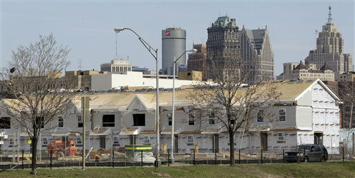 Part of the Detroit skyline is seen behind a housing project under construction in Detroit, Wednesday, April 13, 2011. Some experts say Detroit&#39;s population will decline more over the next decade before possibly climbing back up. Another 100,000 to 200,000 people could leave the financially troubled city, which lost a quarter of its population between 2000 and 2010. &#40;AP Photo&#47;Carlos Osorio&#41; <span class=meta>(AP Photo&#47; Carlos Osorio)</span>