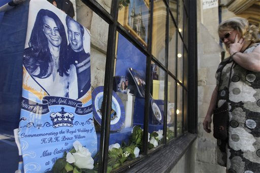 A woman looks into a  Westminster Abbey&#39;s shop window displaying souvenirs of Prince William and Kate Middleton, London, Friday, April 22, 2011. Prince William and Kate Middleton are to marry at Westminster Abbey in London on April 29. &#40;AP Photo&#47;Sang Tan&#41; <span class=meta>(AP Photo&#47; Sang Tan)</span>