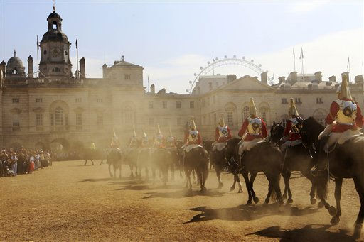 The Life Guards of the Household Cavalry Mounted Regiment ride into the Horse Guards Parade in London for the changing of guards, Friday, April 22, 2011. The Life Guards together with the Blues &amp; Royals will form a Sovereign&#39;s Escort for Queen Elizabeth II and a Captain&#39;s Escort for the bride and groom from Westminster Abbey to Buckingham Palace during the royal wedding of Prince William and Kate Middleton on April 29. &#40;AP Photo&#47;Sang Tan&#41; <span class=meta>(AP Photo&#47; Sang Tan)</span>