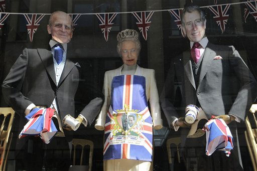 A clothing shop window display its wares with masks depicting Queen Elizabeth II, center, her husband Duke of Edingburgh, left, and her son Prince Charles to celebrate the forthcoming royal wedding of Prince William and Kate Middleton, Friday, April 22, 2011. Prince William and Kate Middleton are to marry at Westminster Abbey in London on April 29. &#40;AP Photo&#47;Sang Tan&#41; <span class=meta>(AP Photo&#47; Sang Tan)</span>