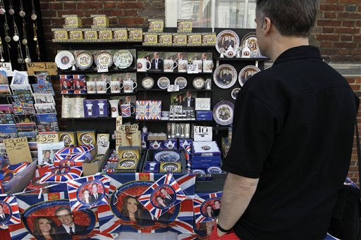 "<div class=""meta image-caption""><div class=""origin-logo origin-image ""><span></span></div><span class=""caption-text"">A man looks at souvenirs of Prince William and Kate Middleton on display at a street stall in London, Friday, April 22, 2011. Prince William and Kate Middleton are to marry at Westminster Abbey in London on April 29. (AP Photo/Sang Tan) (AP Photo/ Sang Tan)</span></div>"