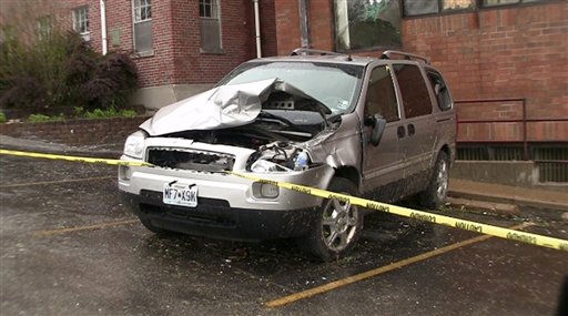 In this image taken from video, a damaged car is seen at Ferguson Christian Church in Ferguson, Mo. Sunday, April 24, 2011.  The church sustained damage during Friday&#39;s tornado. Easter services were moved to St. Louis Christian College in Florissant, Mo. due to the damage. &#40;AP Photo&#47;George Wise&#41; <span class=meta>(AP Photo&#47; George Wise)</span>