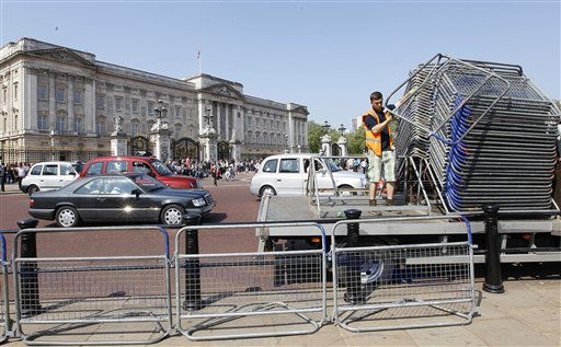 "<div class=""meta image-caption""><div class=""origin-logo origin-image ""><span></span></div><span class=""caption-text"">A worker helps set down a row of barriers outside Buckingham Palace as final preparations are made in London, Monday, April, 25, 2011, for the royal wedding of Britain's Prince William and his fiancee Kate Middleton on Friday. (AP Photo/Alastair Grant) (AP Photo/ Alastair Grant)</span></div>"