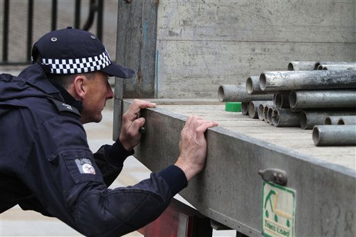 "<div class=""meta image-caption""><div class=""origin-logo origin-image ""><span></span></div><span class=""caption-text"">As part of security preparations for the upcoming royal wedding, a British police officer inspects tubes to be used to built a scaffolded stage reserved for media, outside the Westminster Abbey, in central London, Tuesday, April 26, 2011. Britain's Prince William and Kate Middleton will get married on Friday, April 29, 2011. (AP Photo/Lefteris Pitarakis) (AP Photo/ Lefteris Pitarakis)</span></div>"