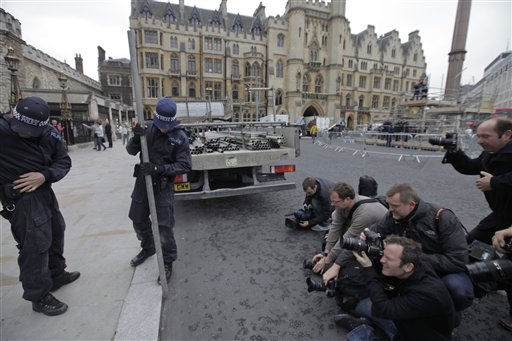 "<div class=""meta ""><span class=""caption-text "">Members of the media, right,  take pictures of British police officers, left, who as part of security preparations for the upcoming royal wedding, inspect tubes to be used to built a scaffolded stage reserved for media, outside the Westminster Abbey, in central London, Tuesday, April 26, 2011. Britain's Prince William and Kate Middleton will get married on Friday, April 29, 2011. (AP Photo/Lefteris Pitarakis) (AP Photo/ Lefteris Pitarakis)</span></div>"