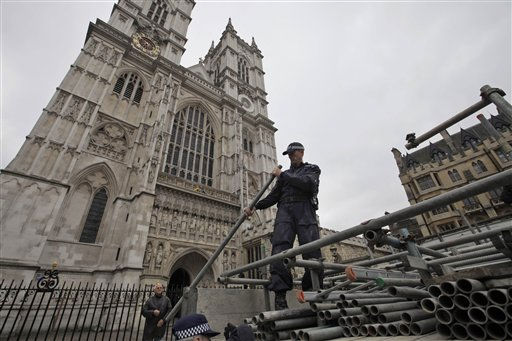 As part of security preparations for the upcoming royal wedding, British police officers inspect tubes to be used to built a scaffolded stage reserved for media, outside the Westminster Abbey, background, in central London, Tuesday, April 26, 2011. Britain&#39;s Prince William and Kate Middleton will get married on Friday, April 29, 2011. &#40;AP Photo&#47;Lefteris Pitarakis&#41; <span class=meta>(AP Photo&#47; Lefteris Pitarakis)</span>