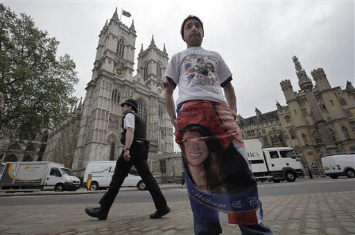 "<div class=""meta ""><span class=""caption-text "">English John Loughray, poses for  photographers in front of the Westminster Abbey in central London, Tuesday, April 26, 2011. Loughray had camped in the spot to make sure he gets the best view for the royal wedding between Britain's Prince William and Kate Middleton on Friday, April 29, 2011. (AP Photo/Lefteris Pitarakis) (AP Photo/ Lefteris Pitarakis)</span></div>"