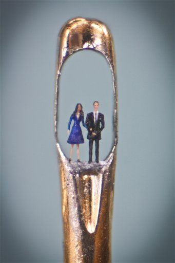 This unadted image made available ion London, Tuesday April 26, 2011, shows the latest work by micro-sculpture artist Willard Wigan, showing Britain&#39;s Prince William and Kate Middleton in an eye of a needle, and which is on display at The Castle Gallerty in Birmingham. Wigan, an artist celebrated for his tiny creations, fashioned the piece, which can only be viewed through a microscope, from synthetic fibre and painted it using a single eyelash.&#40;AP Photo&#47;Richard Baddeley, ho&#41;  EDITORIAL USE ONLY <span class=meta>(AP Photo&#47; Richard Baddeley)</span>