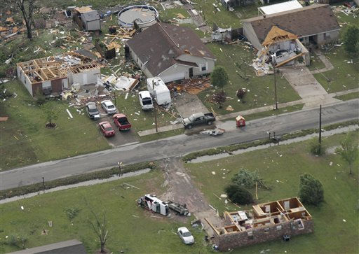 "<div class=""meta ""><span class=""caption-text "">Cleanup begins in a Vilonia, Ark., neighborhood Tuesday, April 26, 2011, after a tornado struck the area late Monday. The storm system killed at least seven people, including three who drowned in floods in northwest Arkansas. (AP Photo/Danny Johnston) (AP Photo/ Danny Johnston)</span></div>"