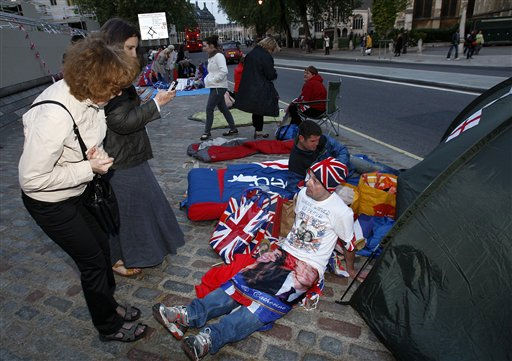 John Loughrey, a fan of Princess Diana, talks with a passer-by outside Westminster Abbey in London, Tuesday, April 26, 2011.  Revelers are camping out outside the Abbey where Prince William and Kate Middleton are due to get married on Friday, April 29. &#40;AP Photo&#47;Akira Suemori&#41; <span class=meta>(AP Photo&#47; Akira Suemori)</span>