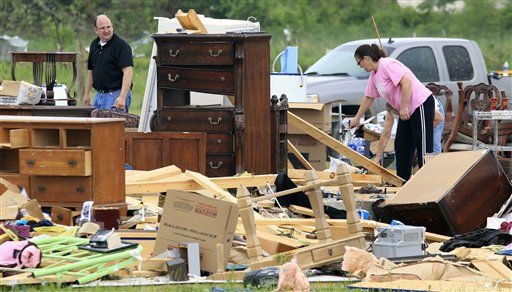 Carla Arendal, right, looks for items to save on Tuesday, April 26, 2011, after her home was destroyed by a tornado in Vilonia, Ark. Arendal and her husband were in the home during the storm but were uninjured. Helping to recover items is Arendal&#39;s minister, Pastor Tommy Walls, left. &#40;AP Photo&#47;Mark Humphrey&#41; <span class=meta>(AP Photo&#47; Mark Humphrey)</span>