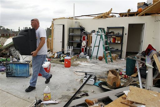 "<div class=""meta ""><span class=""caption-text "">Todd James help salvage items from the home of his friend, Richard Bass, on Tuesday, April 26, 2011, after Bass' home was damaged by a tornado  in Vilonia, Ark. Bass and his family were home when the storm hit, but were uninjured. (AP Photo/Mark Humphrey) (AP Photo/ Mark Humphrey)</span></div>"