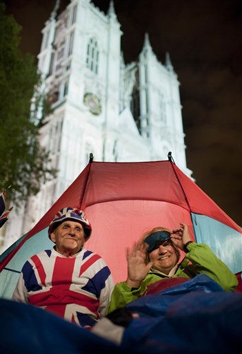 Royal fans Terry Hutt, left, and Jennifer Hawkins, right, sit in their tent in front of Westminster Abbey in London, late Tuesday night, April 26, 2011. Revelers are camping out outside the Abbey where Prince William and Kate Middleton are due to get married on Friday, April 29. &#40;AP Photo&#47;Gero Breloer&#41; <span class=meta>(AP Photo&#47; Gero Breloer)</span>