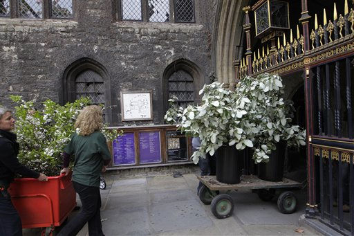 "<div class=""meta image-caption""><div class=""origin-logo origin-image ""><span></span></div><span class=""caption-text"">Florists deliver flowers to Westminster Abbey in London, during preparations for the upcoming royal wedding between Kate Middleton and Britain's Prince William,  Wednesday, April 27, 2011.  Prince William will marry Kate Middleton in Westminster Abbey on April 29. (AP Photo/Sang Tan, Pool) (AP Photo/ Sang Tan)</span></div>"
