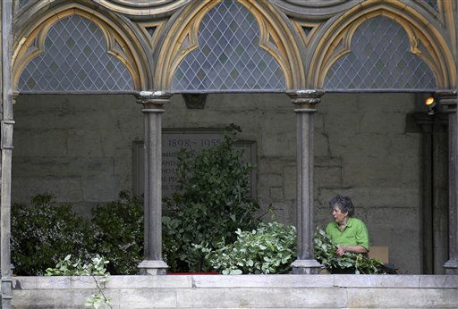 A member of National Association of Flower Arranging Societies, prepares flowers in Westminster Abbey, London, during preparations for upcoming royal wedding between Kate Middleton and Britain&#39;s Prince William,  Wednesday, April 27, 2011.  Prince William and Kate Middleton are to marry in Westminster Abbey on April 29.  &#40;AP Photo&#47;Sang Tan, Pool&#41; <span class=meta>(AP Photo&#47; Sang Tan)</span>