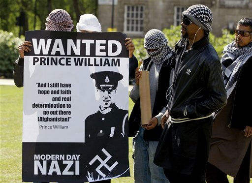 Islamic protestors hold banners as they speak with media in London, Wednesday, April 27, 2011. The protestors have been banned by police from demonstrating during the royal wedding. &#40;AP Photo&#47;Kirsty Wigglesworth&#41; <span class=meta>(AP Photo&#47; Kirsty Wigglesworth)</span>