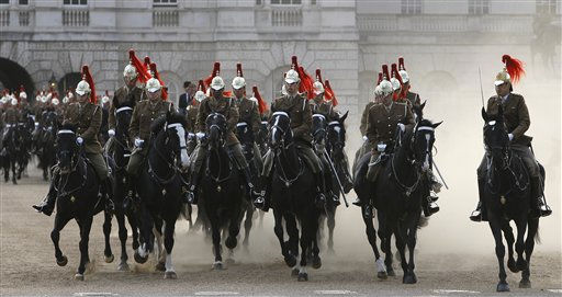 Soldiers of the Household Cavalry cross Horseguards as they take part in an overnight dress rehearsal for the Royal Wedding of Britain&#39;s Prince William and Kate Middleton, in central London, Wednesday, April, 27, 2011. Prince William is to marry Kate Middleton at Westminster Abbey in London, on Friday, April 29. &#40;AP Photo&#47;Alastair Grant&#41; <span class=meta>(AP Photo&#47; Alastair Grant)</span>