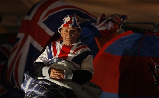 Terry Hutt fan of the British Royal Family sits outside his tent near Westminster Abbey in central London, Wednesday, April, 27, 2011. Prince William is to marry Kate Middleton at Westminster Abbey in London, on Friday, April 29. Hutt was one of the first people to arrive for the event and will sleep on the street to hold prime position for the wedding. &#40;AP Photo&#47;Alastair Grant&#41; <span class=meta>(AP Photo&#47; Alastair Grant)</span>