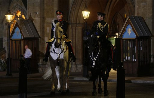 "<div class=""meta image-caption""><div class=""origin-logo origin-image ""><span></span></div><span class=""caption-text"">Officers on their horses stand watch outside Westminster Abbey as they take part in an overnight dress rehearsal for the Royal Wedding of Britain's Prince William and Kate Middleton, in central London, Wednesday, April, 27, 2011. Prince William is to marry Kate Middleton at Westminster Abbey in London, on Friday, April 29. (AP Photo/Alastair Grant) (AP Photo/ Alastair Grant)</span></div>"