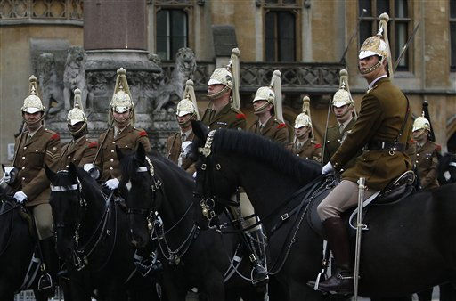 Soldiers of the Household Cavalry wait for orders outside Westminster Abbey as they take part in an overnight dress rehearsal for the Royal Wedding of Britain&#39;s Prince William and Kate Middleton, in central London, Wednesday, April, 27, 2011. Prince William is to marry Kate Middleton at Westminster Abbey in London, on Friday, April 29. &#40;AP Photo&#47;Alastair Grant&#41; <span class=meta>(AP Photo&#47; Alastair Grant)</span>