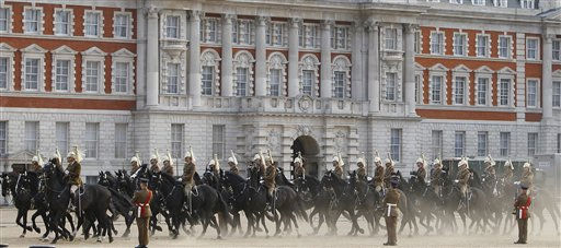 "<div class=""meta ""><span class=""caption-text "">Soldiers of the Household Cavalry cross Horseguards as they take part in an overnight dress rehearsal for the Royal Wedding of Britain's Prince William and Kate Middleton, in central London, Wednesday, April, 27, 2011. Prince William is to marry Kate Middleton at Westminster Abbey in London, on Friday, April 29. (AP Photo/Alastair Grant) (AP Photo/ Alastair Grant)</span></div>"