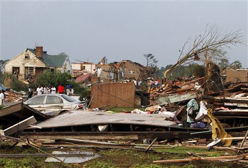 "<div class=""meta ""><span class=""caption-text "">Residents survey the destruction after a tornado hits Pratt City just north of downtown Birmingham on Wednesday, April 27, 2011, in Birmingham, Ala.   The widespread destruction caused Gov. Robert Bentley to declare a state of emergency by midday, saying tornadoes, severe thunderstorms, hail, and straight-line winds caused damage to ""numerous homes and businesses"" in Alabama. (AP Photo/Butch Dill) (AP Photo/ Butch Dill)</span></div>"